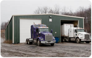 Green preengineeredBuildings For Truck Storage pictured